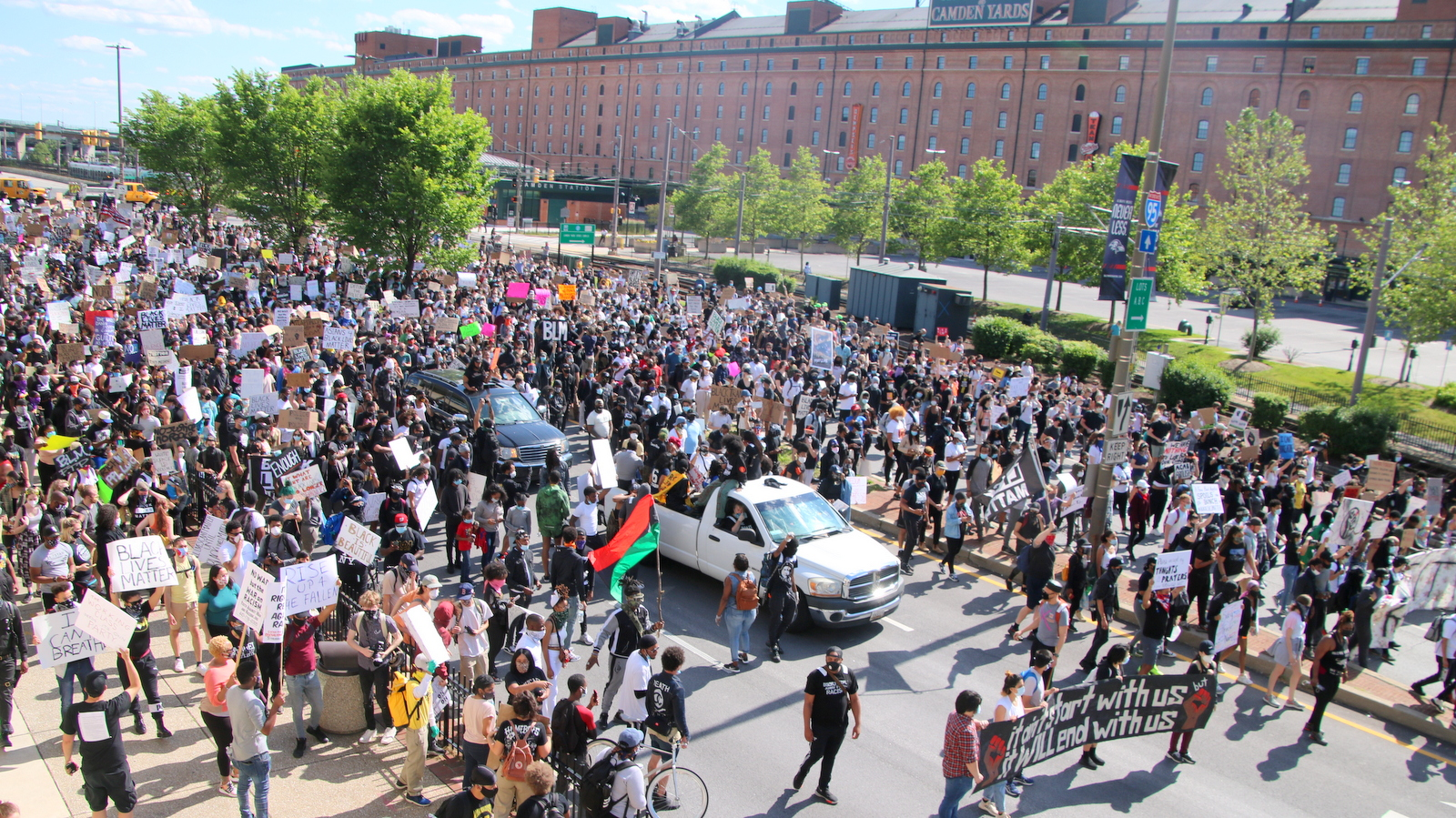 A massive crowd protesting police brutality march up Howard Street past Baltimore's Camden Yards. (Louis Krauss)