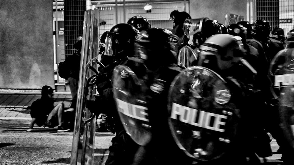 Police in riot gear confront protesters during Baltimore's protest following the death of George Floyd. (J. M. Giordano)