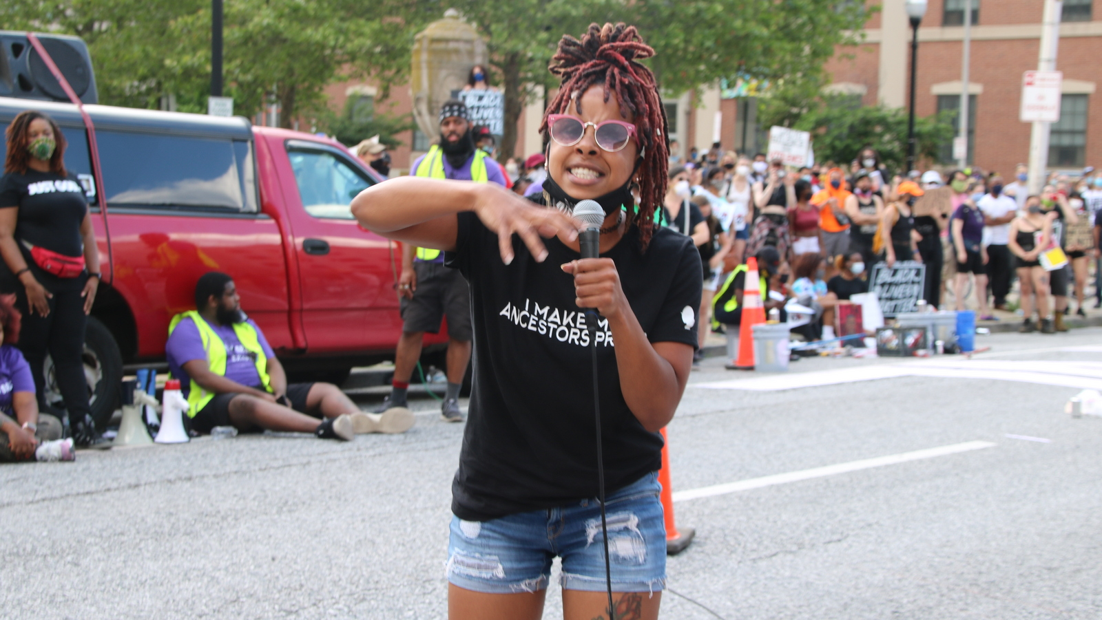 Kish the Lioness performs at the protest. (Louis Krauss)
