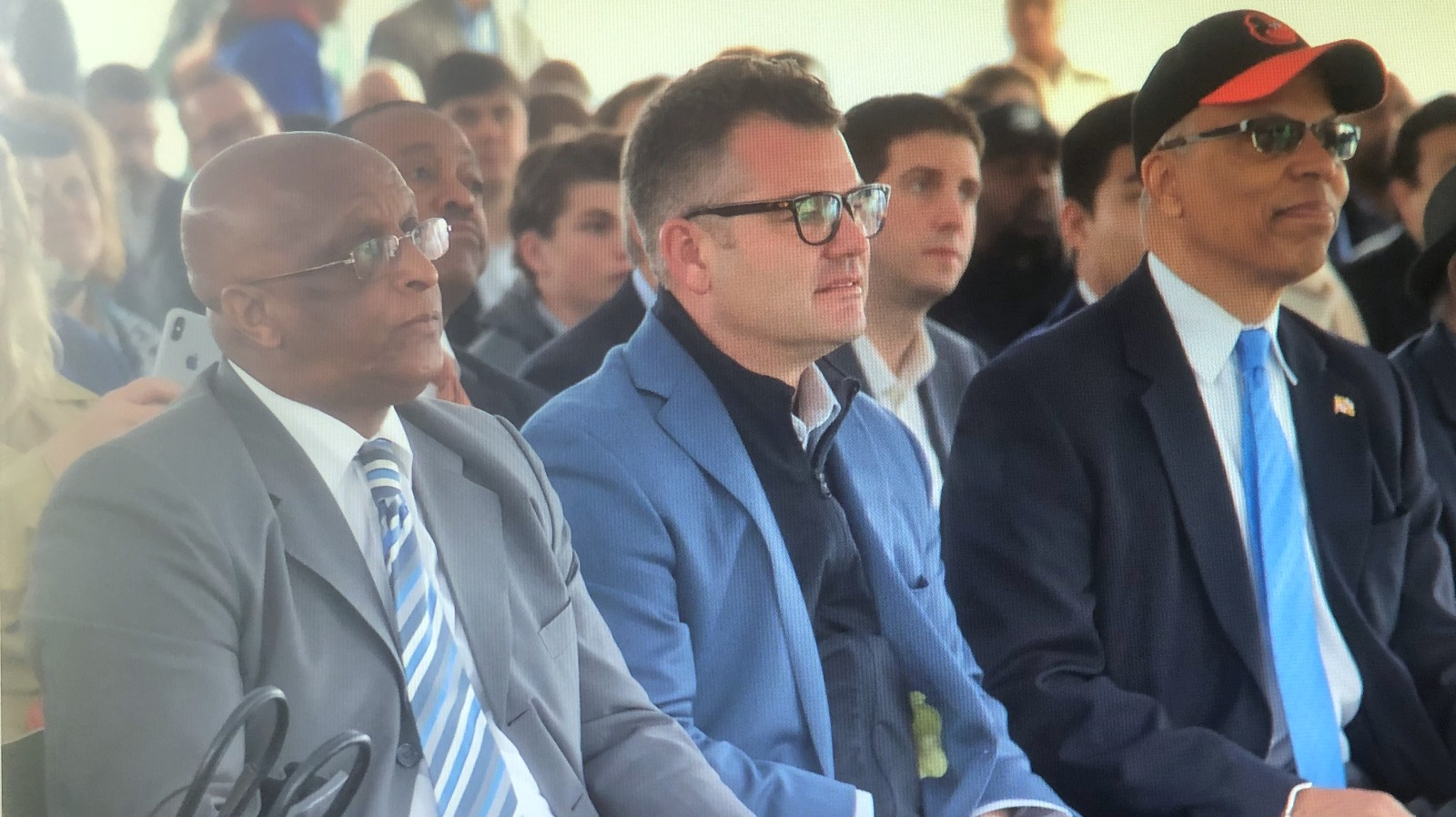 Developer Marc Weller sits between Baltimore Mayor Jack Young (left) and Maryland Lt. Governor Boyd Rutherford at a ceremonial groundbreaking event at Port Covington last year. (xxx)
