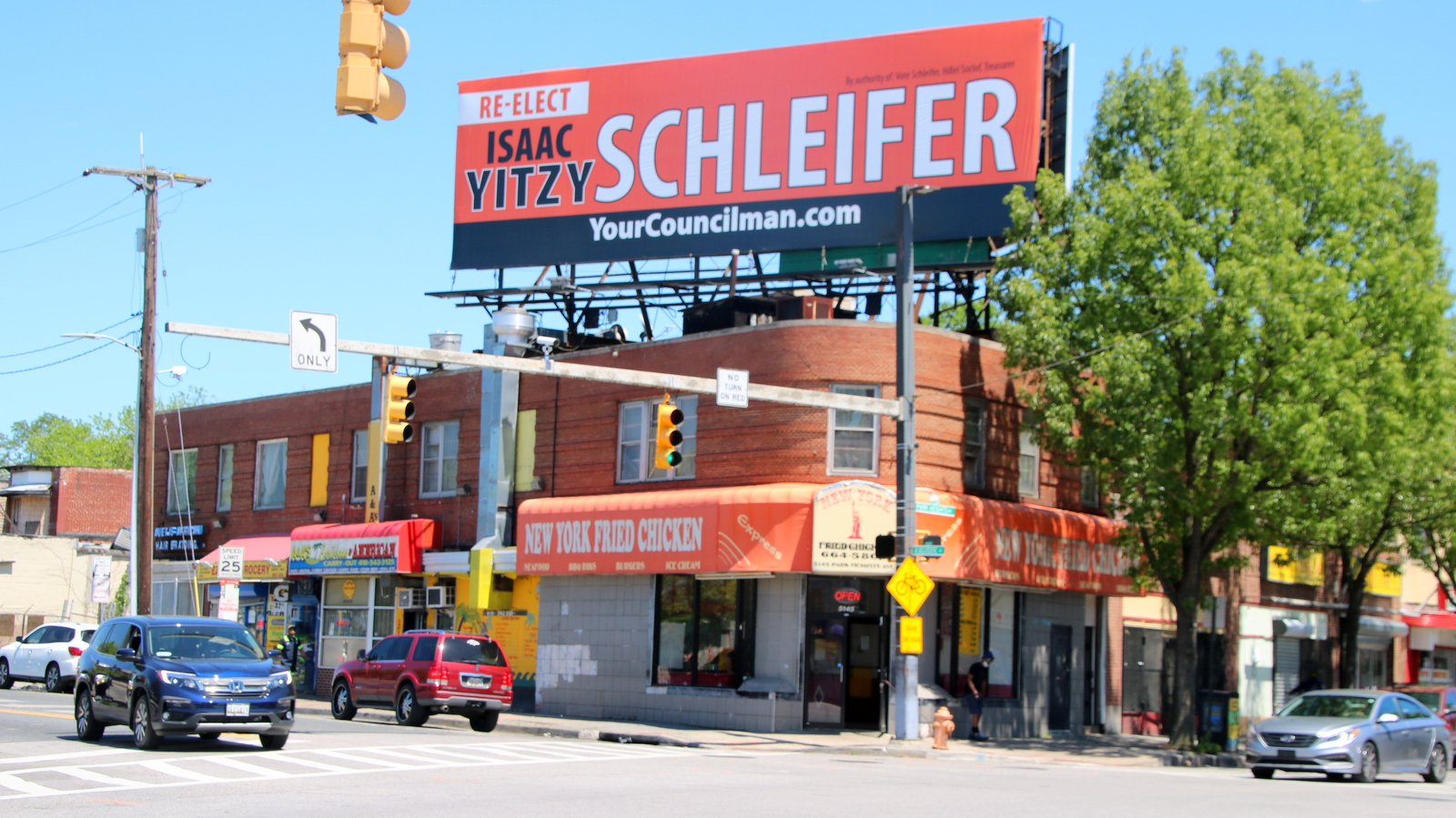 A huge campaign sign behind Pimlico RaceCcourse for 5th District Councilman Yitzy Schleifer. (Fern Shen)