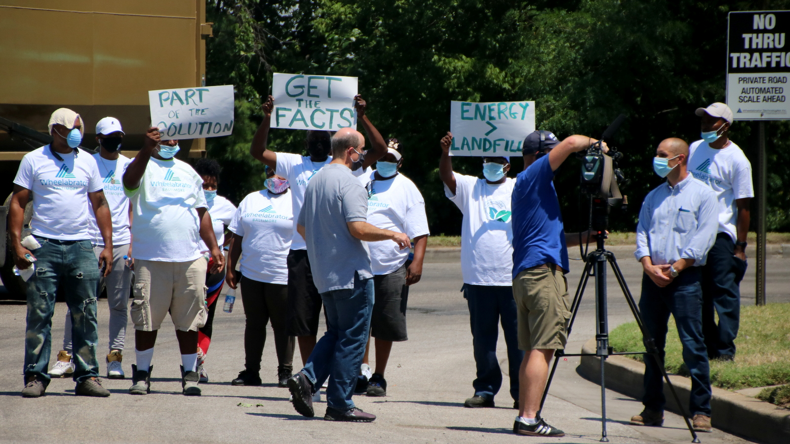 A group wearing Wheelabrator shirts stages a counter-protest. (Louis Krauss)