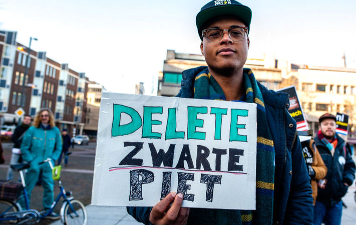 A protestor at a recent rally against the Dutch holiday character,