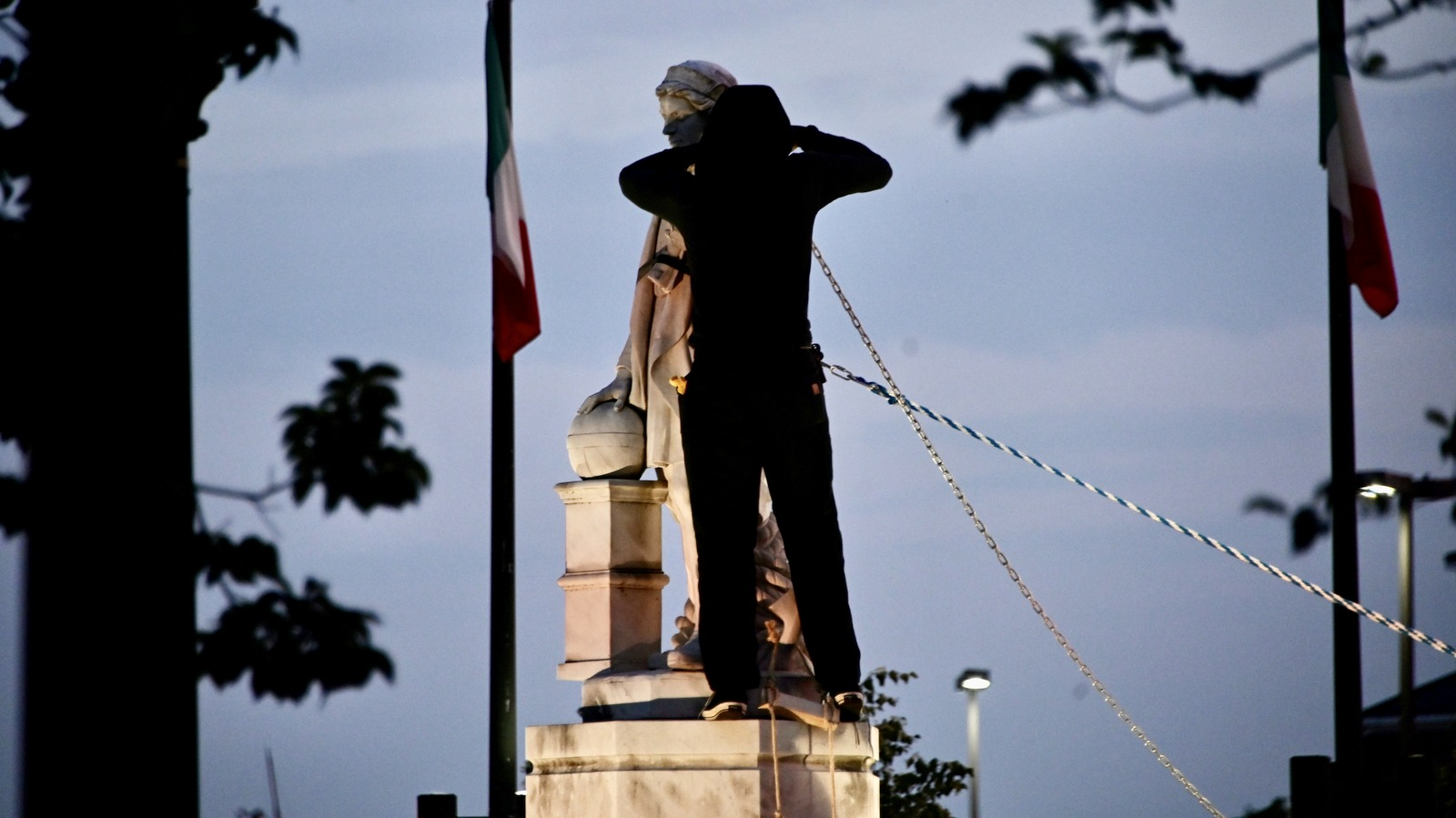 A protester prepares the Columbus statue to be toppled. (J.M. Giordano)