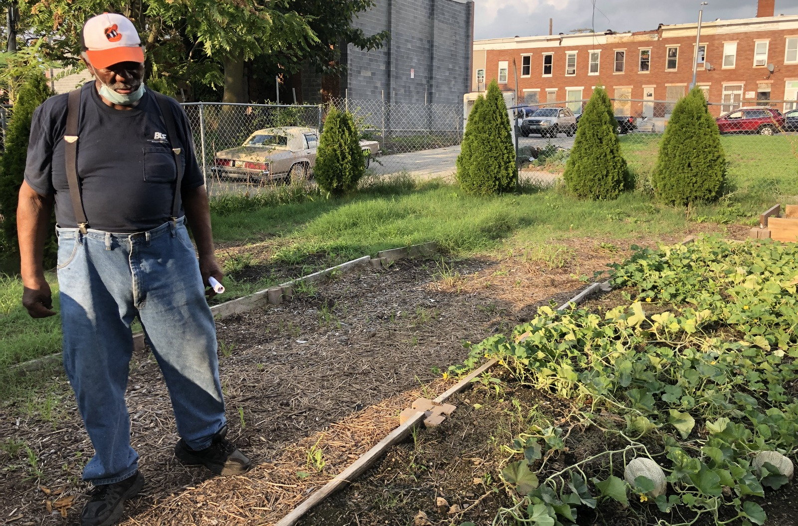 Lewis Sharpe beside the melon patch at the Duncan Street Miracle Garden. (Ian Round)