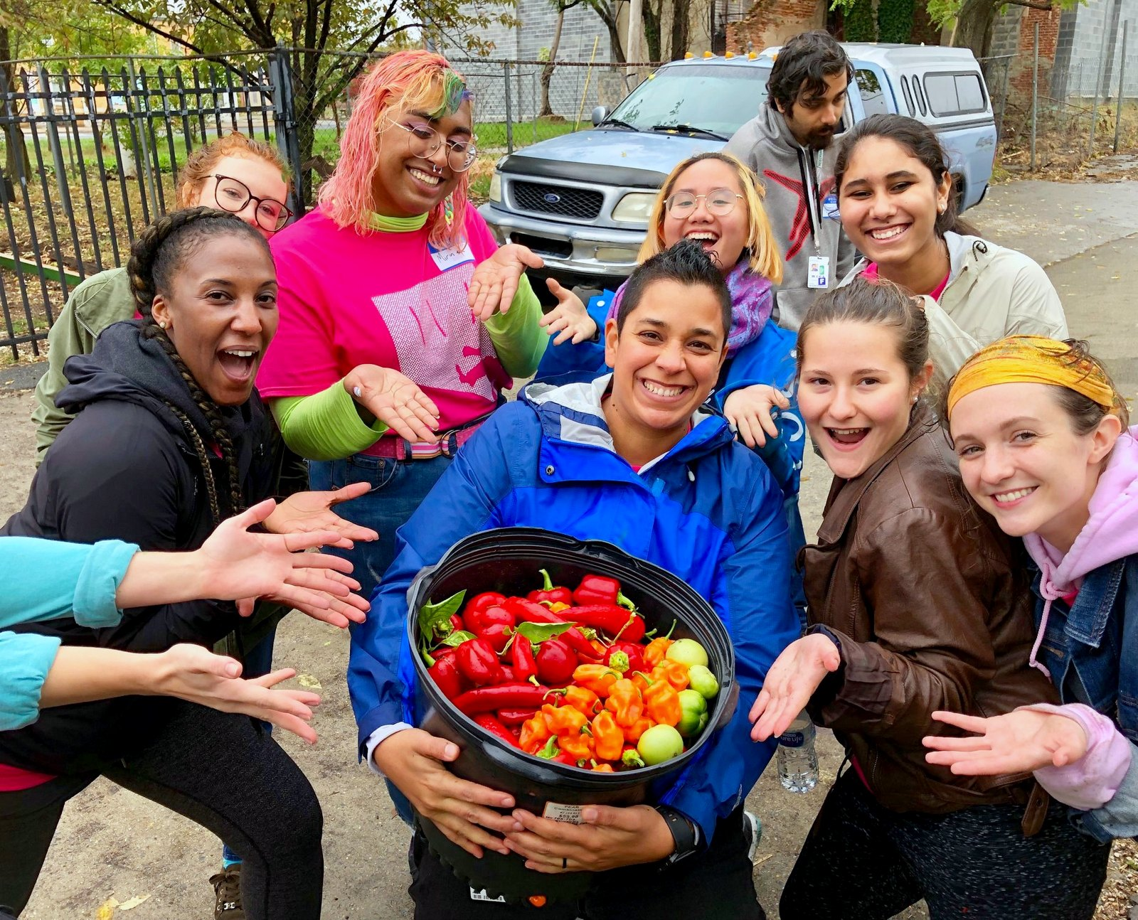 Volunteers from the MICA Center for Student Engagement show off the harvest last fall at Duncan Street Miracle Garden. (Facebook)
