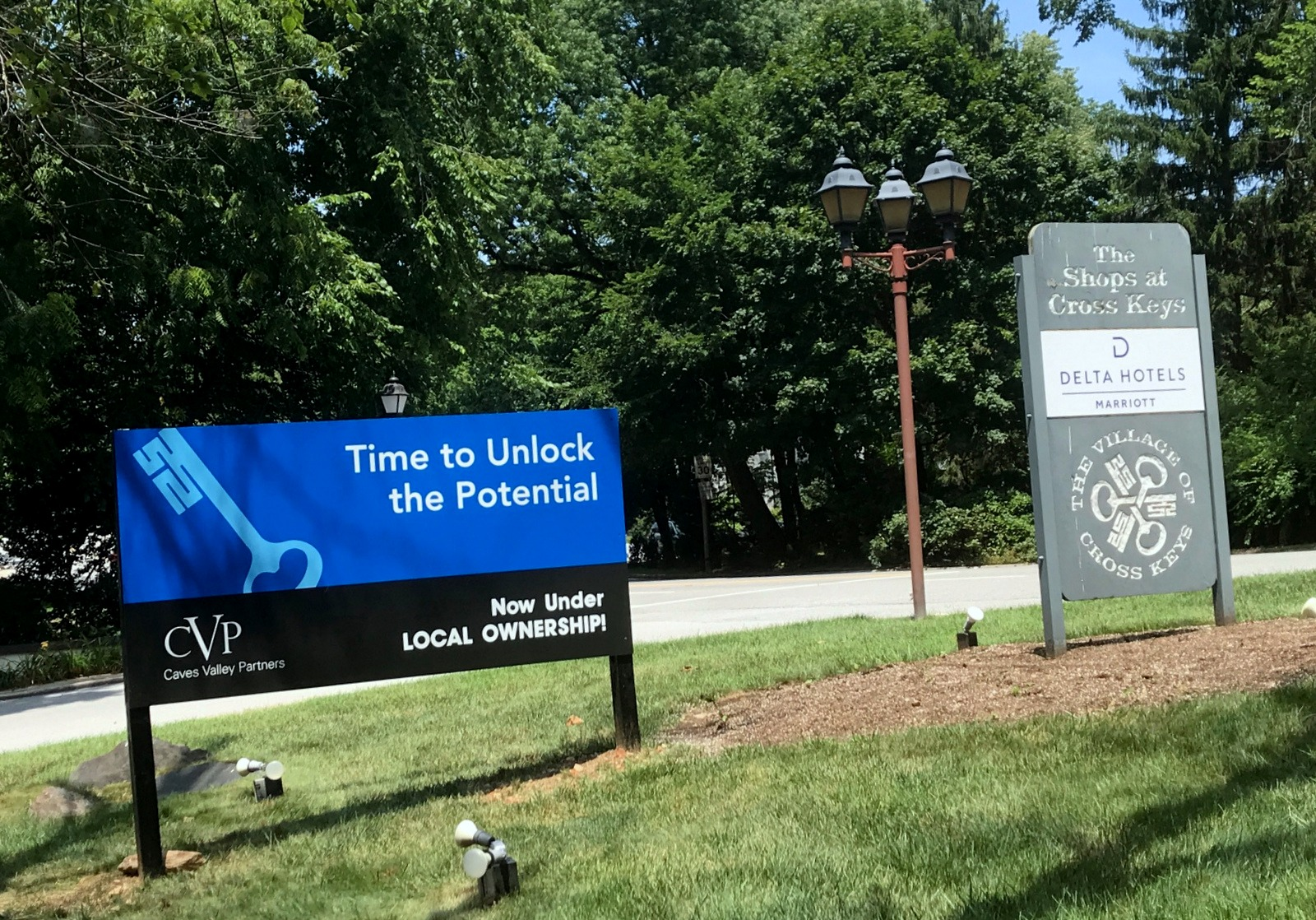 The Falls Road entrance to the Village features upbeat signage from the property's new owner. (Mark Reutter)