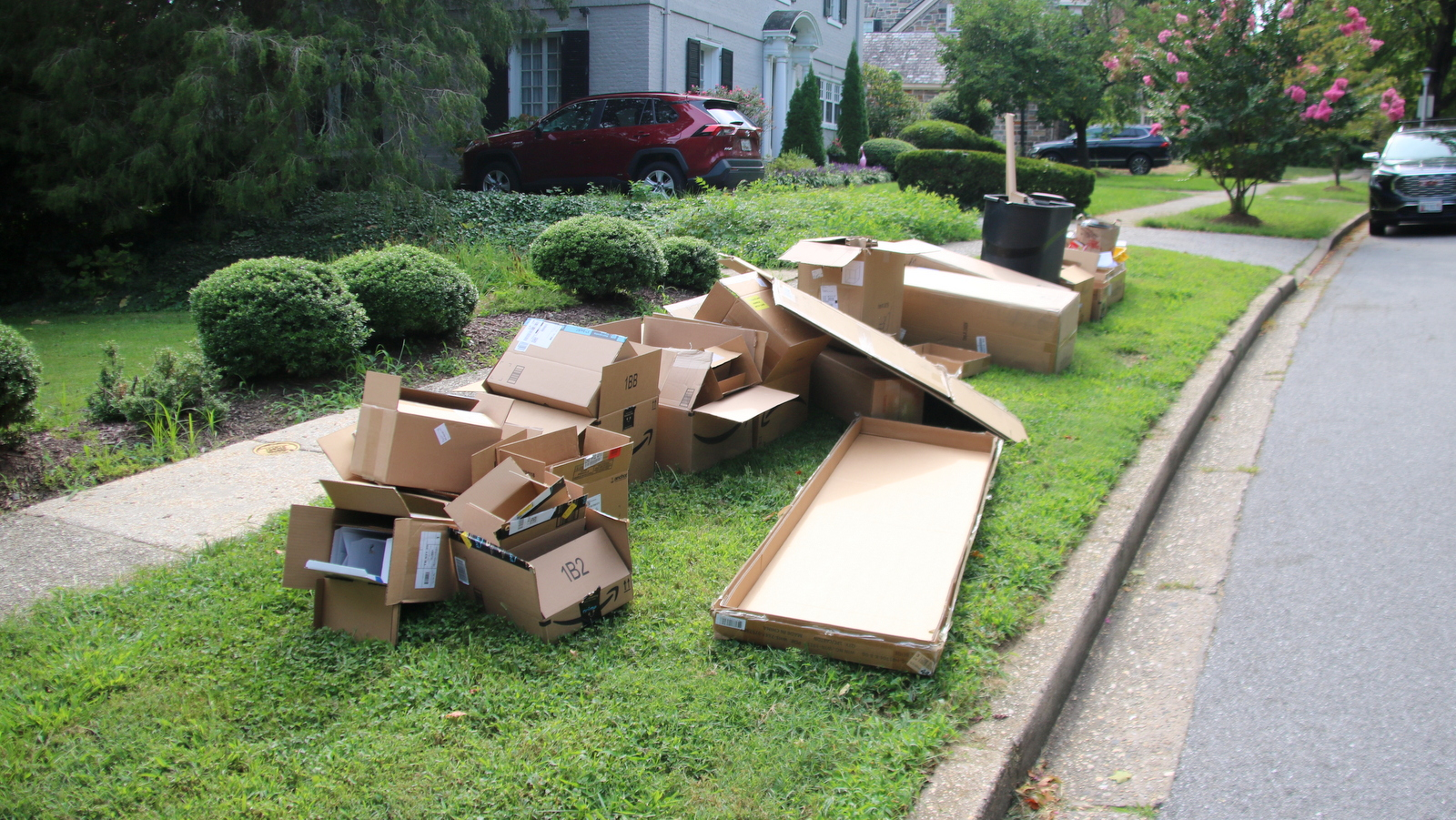 Cardboard and other recyclable materials are everywere in Baltimore, ahead of the city's suspension of recycling pickups. (Louis Krauss)