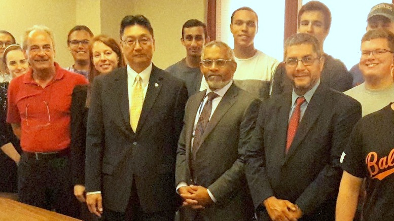 Johnnie Hemphill (center, dark tie) during a 2019 visit to a UMBC class by DPW director Rudy Chow. (umbc.edu)