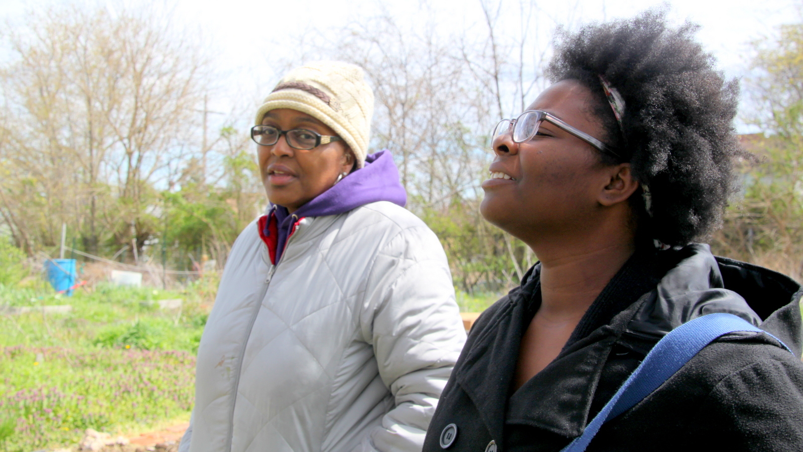 Activist Destiny Watford in the Filbert Street Garden in 2016 after the Maryland Department of the Environment declared Energy Answers' incinerator permit expired. At left, Rodette Jones. (Fern Shen)
