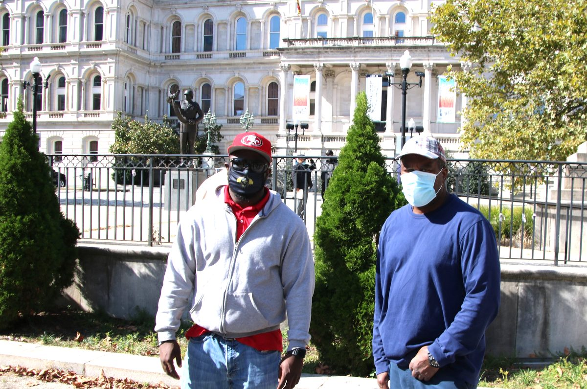 Water meter technicians David Owns and Eric Diggs in front of City Hall today. (Louis Krauss)