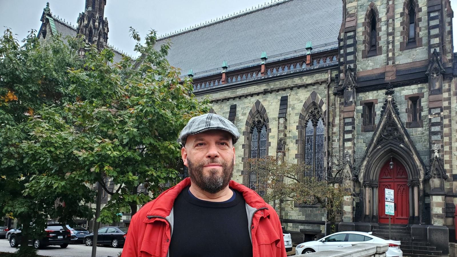 SILENCED: Drew Rieger stands next to United Methodist Church he wanted to testify about. (Ed Gunts)