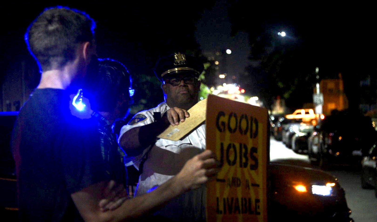 Police confront demonstrators at pre-dawn anti-incinerator protest at the home of Mayor Jack Young. (J.M. Giordano)