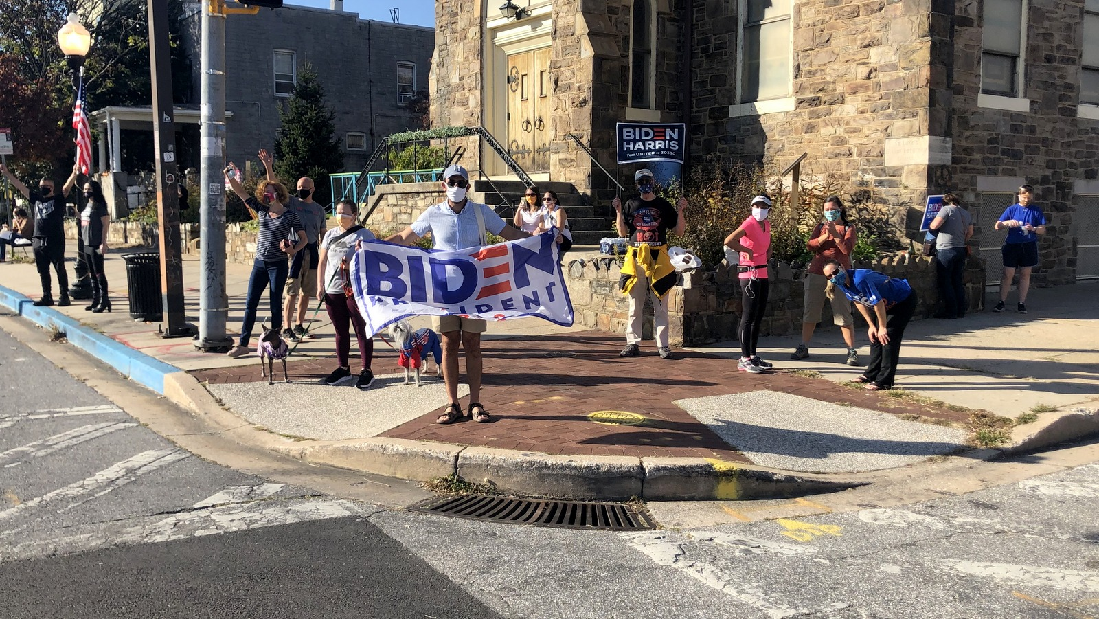 In Baltimore, passing motorists honked in support, as revelers celebrated the Biden-Harris victory. (Fern Shen)