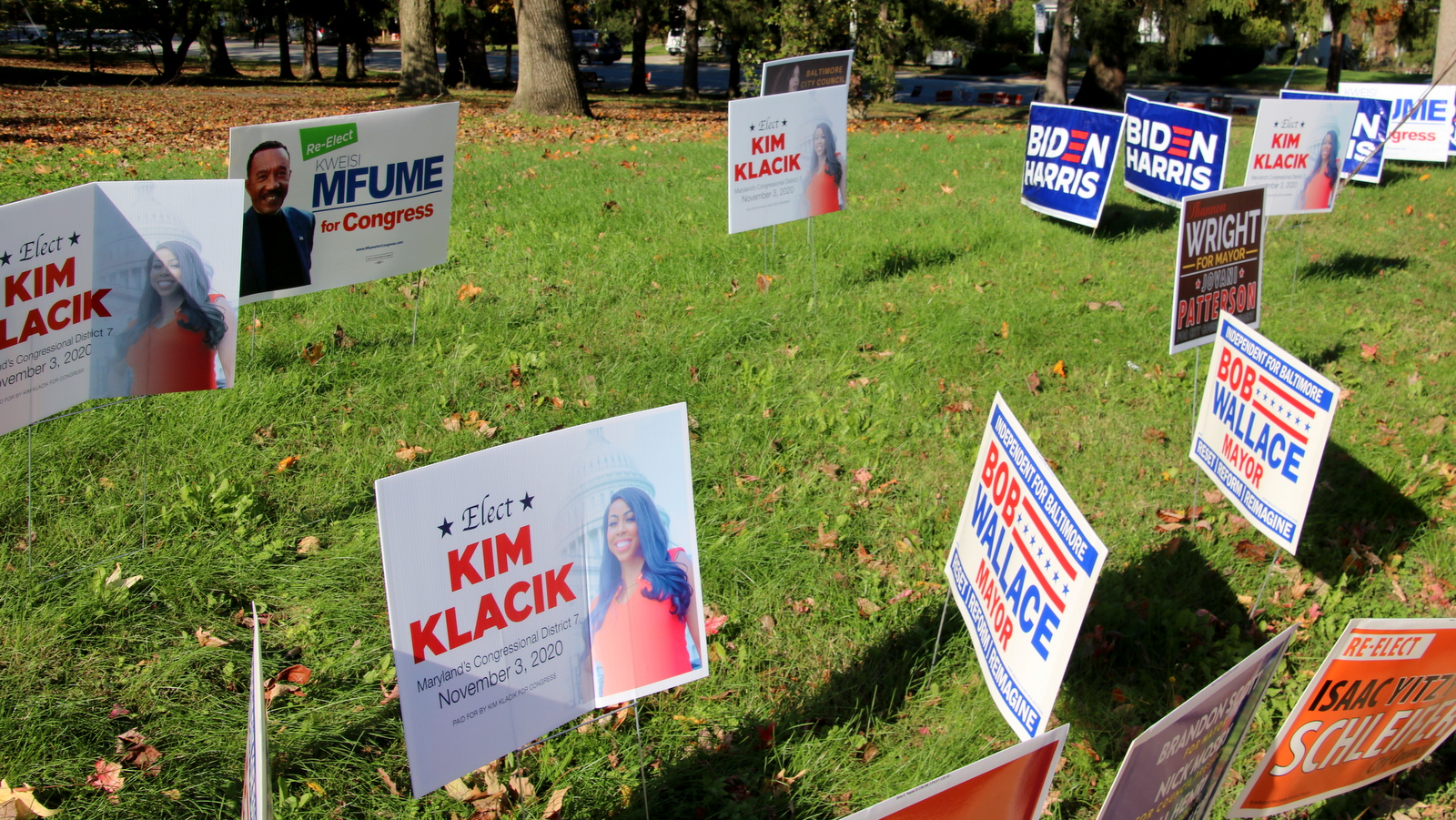 Campaign signs for the 2020 General Election outside a Northeast Baltimore early voting center. (Louis Krauss)