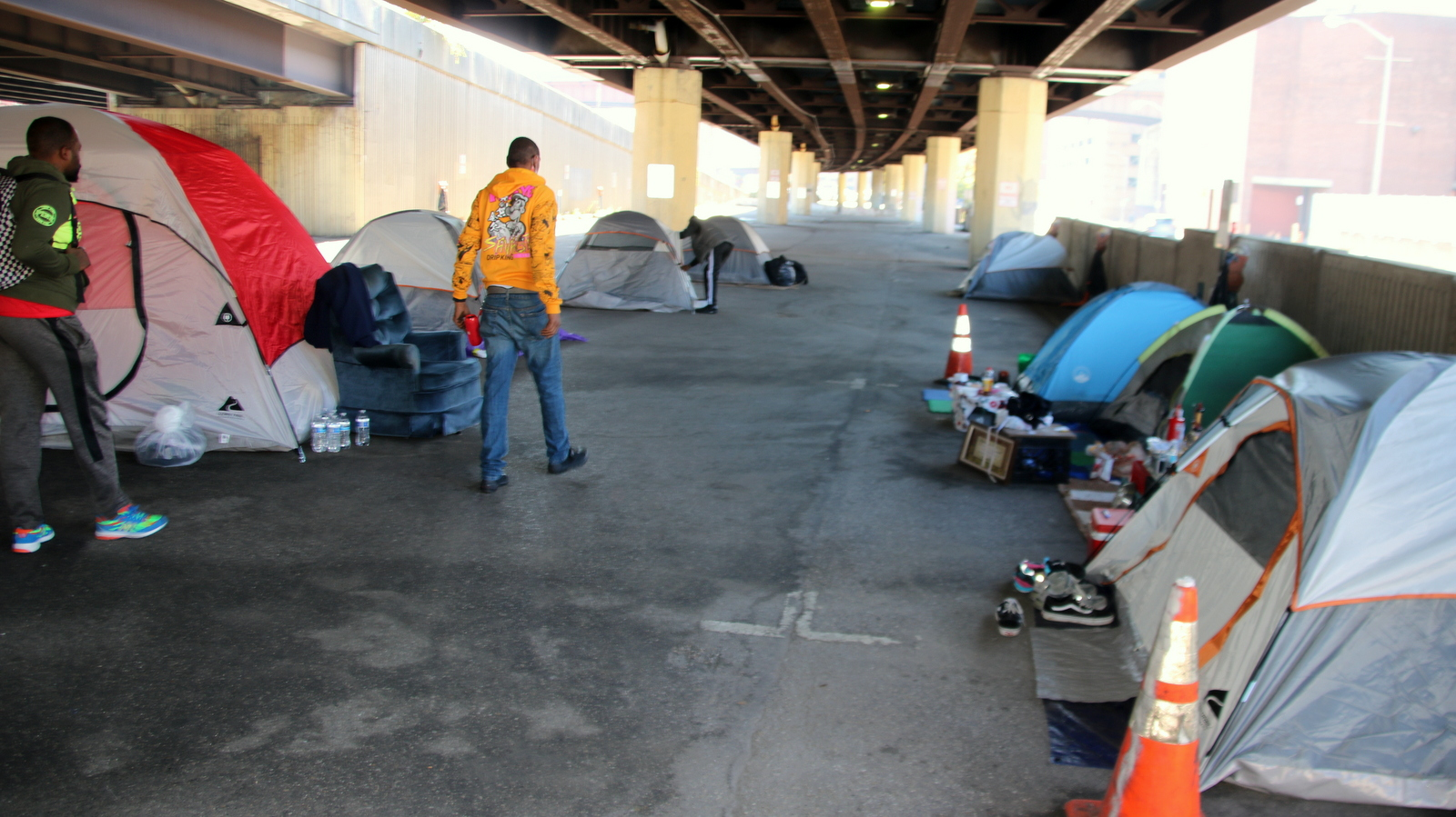 About 30 people living under the Jones Falls Expressway say the city is poised to kick them out. (Louis Krauss)