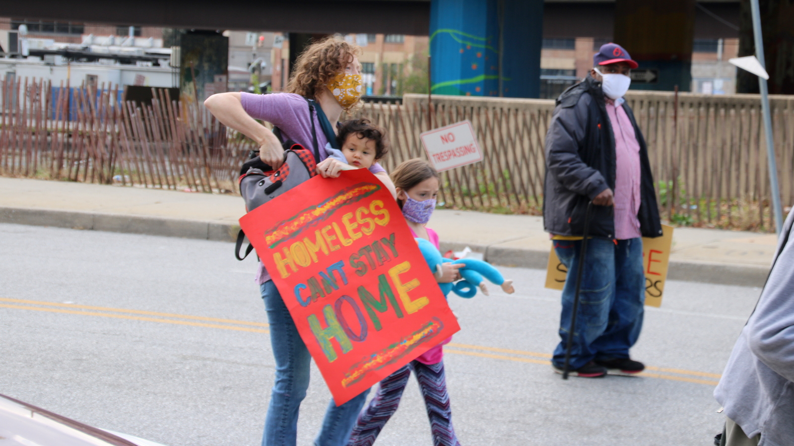 Protesters at a march in Baltimore say, with Covid-19 cases surging, homeless people should not be returned to shelters. (Louis Krauss)