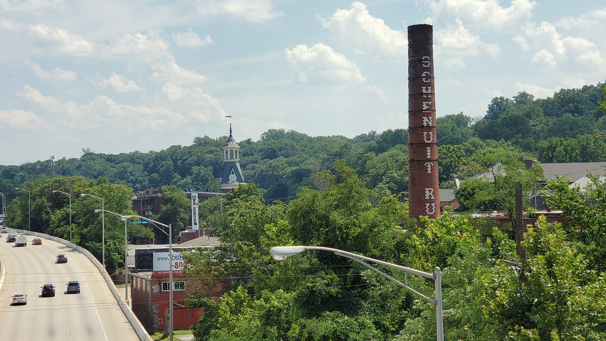 A familiar sight to motorists on I-83, the smokestack of the Schenuit building, which partially collapsed last night. (Ed Gunts)