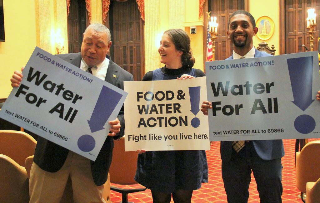 Then councilmen Bill Henry and Brandon Scott flank Rianna Eckel in welcoming passage of the Water Accountability and Equity Act in 2019. (@fwwatch)