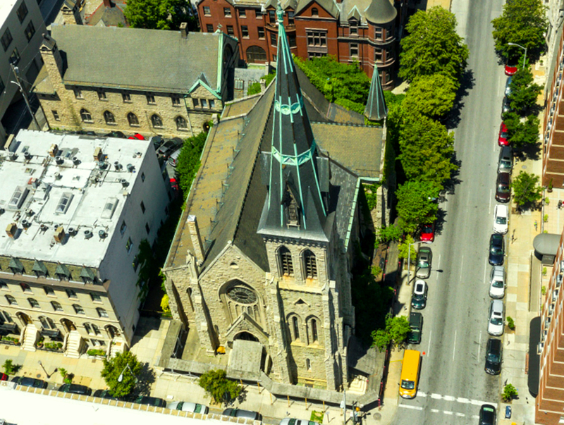 Aerial view of the church with its soaring copper and slate-tile bell tower. (ajbilling.com)