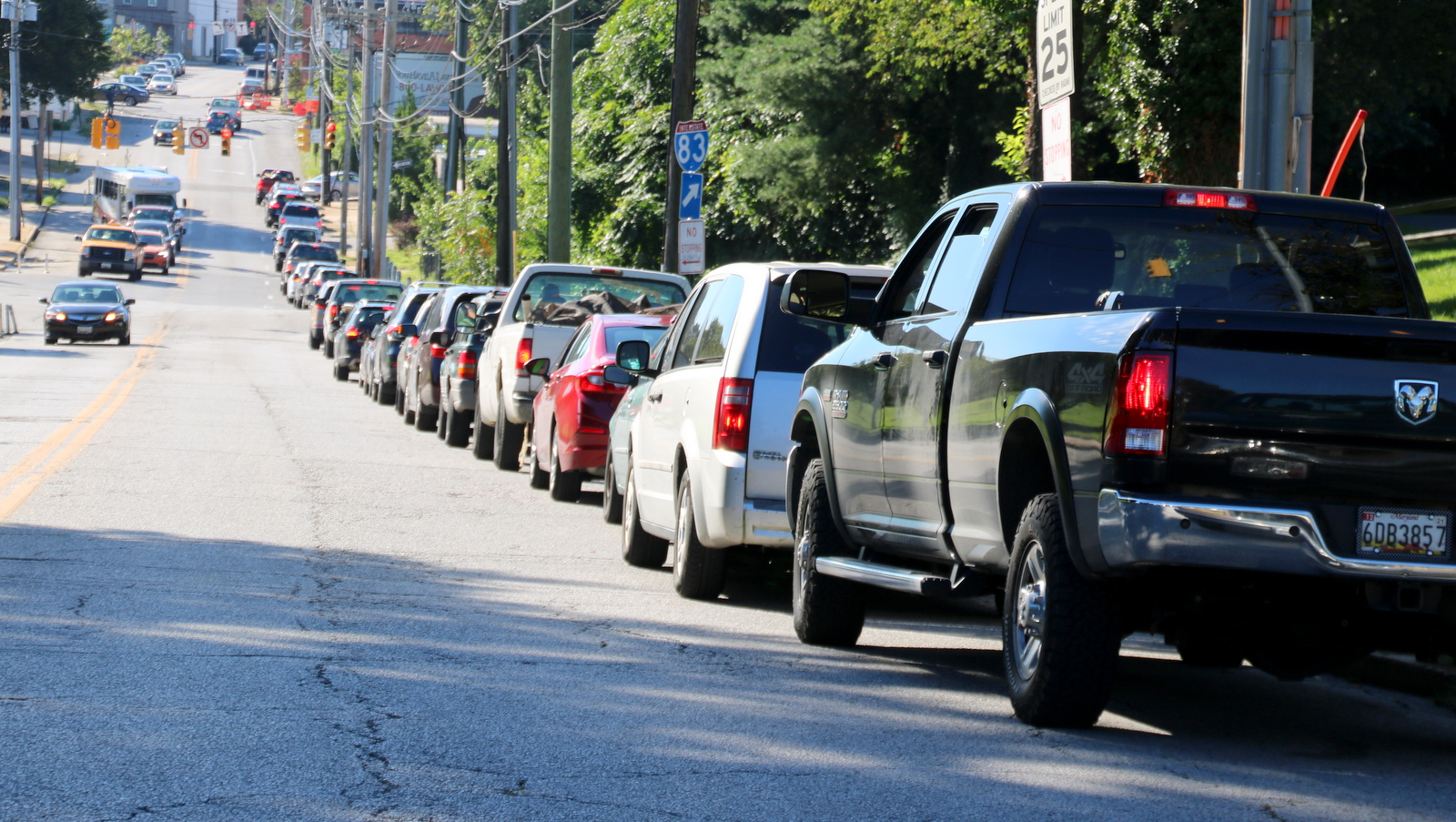 Vehicles wait to get into Baltimore's Sisson Street drop-off center, after curbside recycling collection was suspended in August. (Fern Shen)