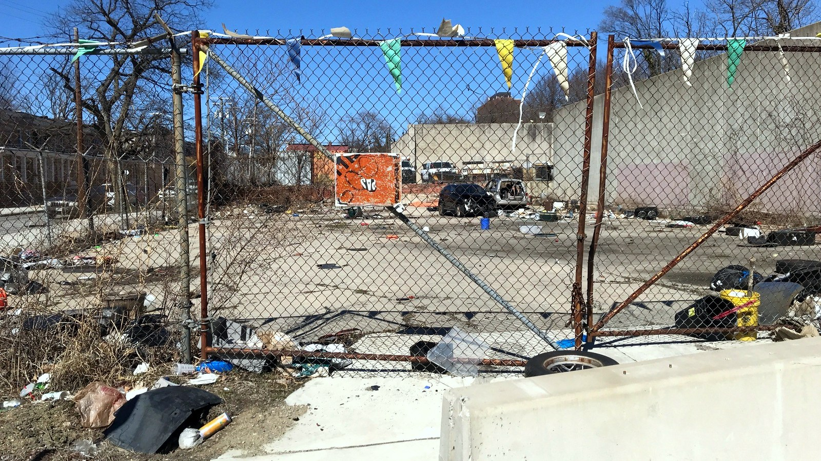 While seeking to increase fines for illegal dumpers, the City Council could examine the sanitary conditions of city-owned properties, such as this former service garage lot at 1601-57 Braddish Avenue in West Baltimore. (Mark Reutter)