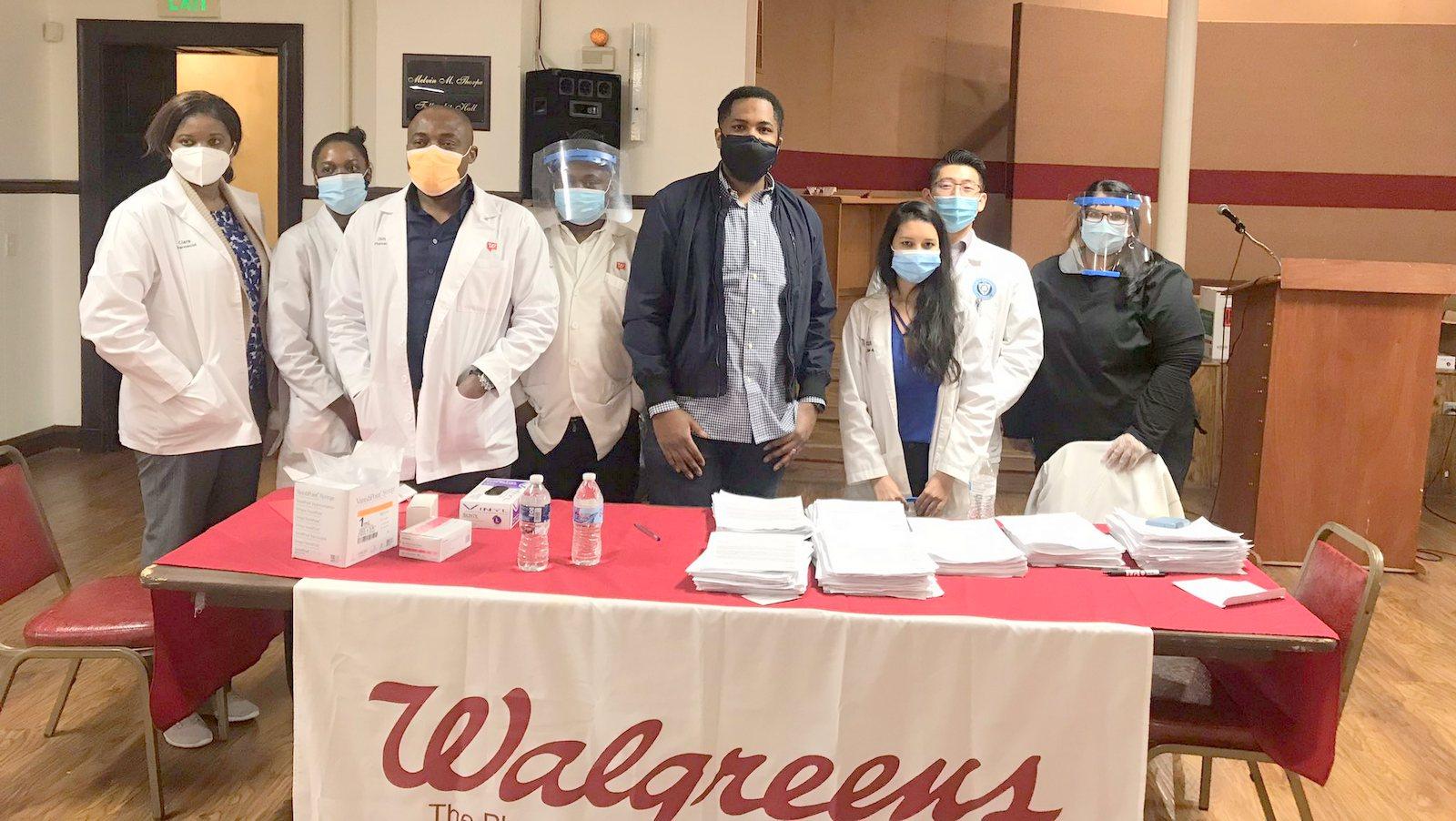 Del. Marlon Amprey with vaccine clinic staff. (@marlonamprey)