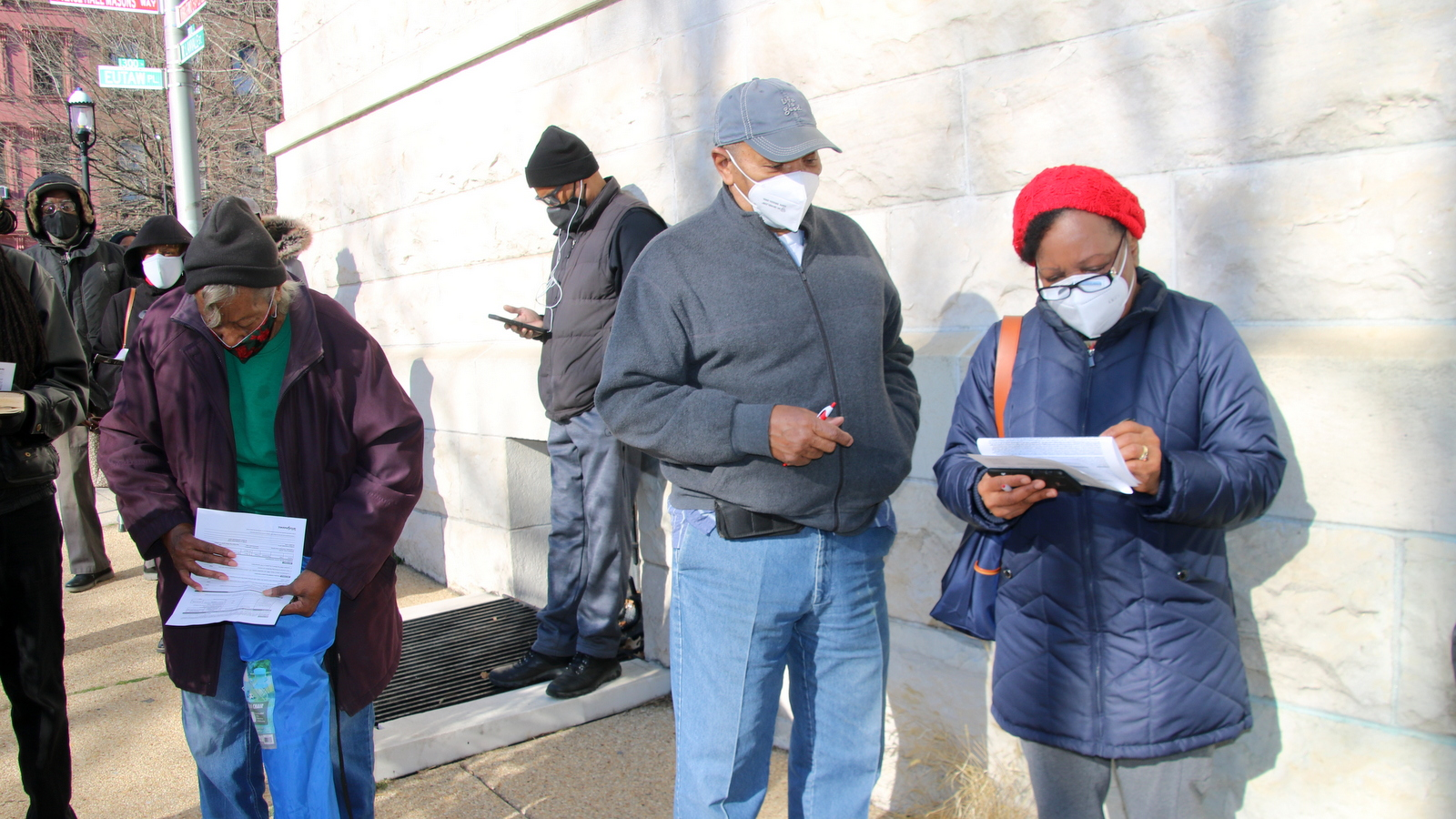 Edward and Gloria Moaney, in line for a free shot of the Johnson & Johnson vaccine, fill out paperwork. (Fern Shen)