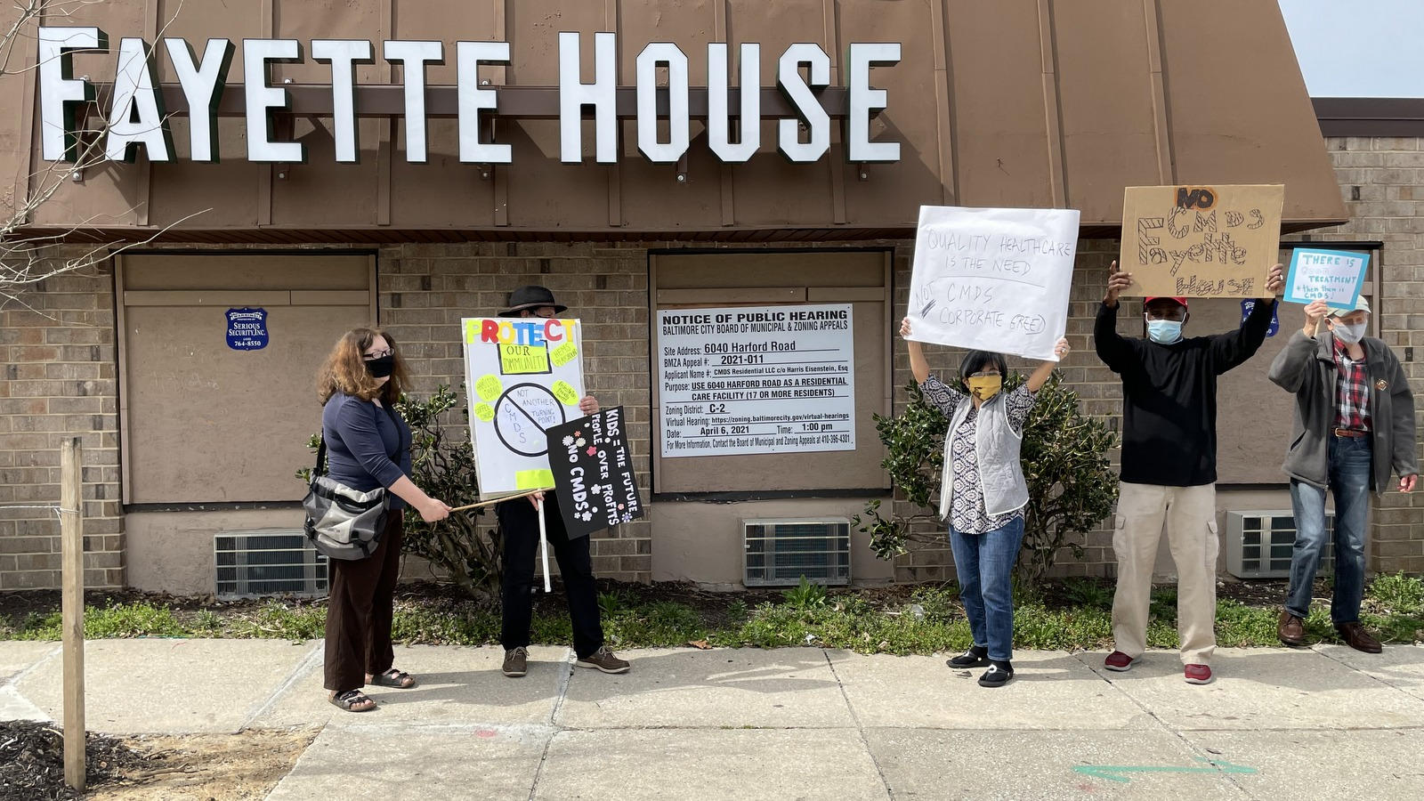 Angela Jancius (far left) and other area residents protest outside Fayette House. (Fern Shen)
