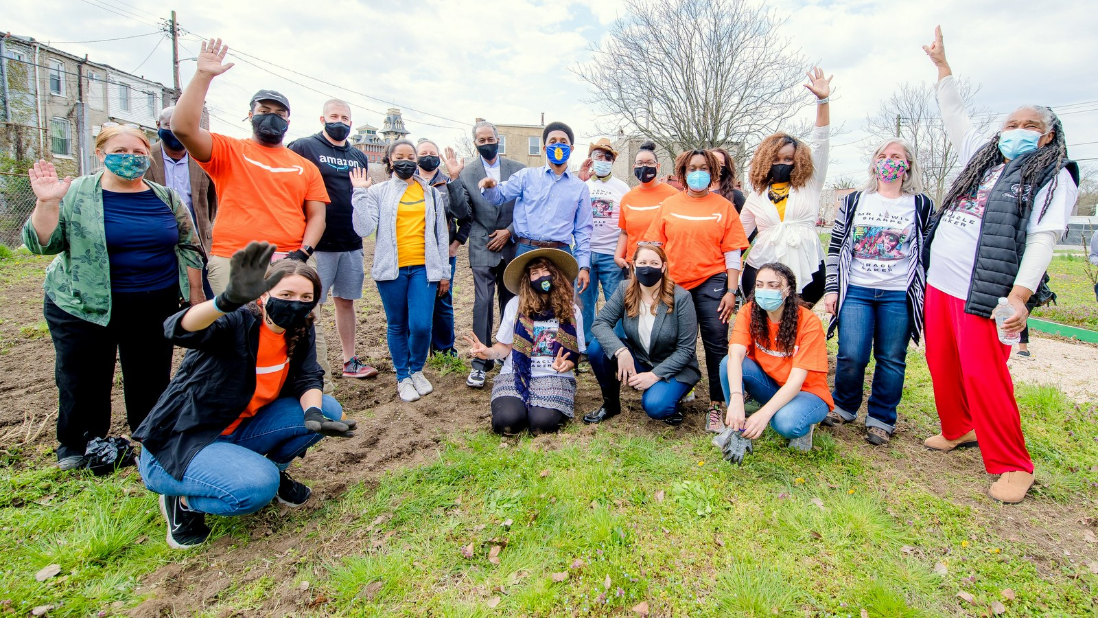 Posing together as Duncan Street Miracle Garden receives a $10,000 gift: Amazon volunteers, Mayor Sccott and Councilman Stokes (center) and Doris Minor-Terrell. (Handout photo)