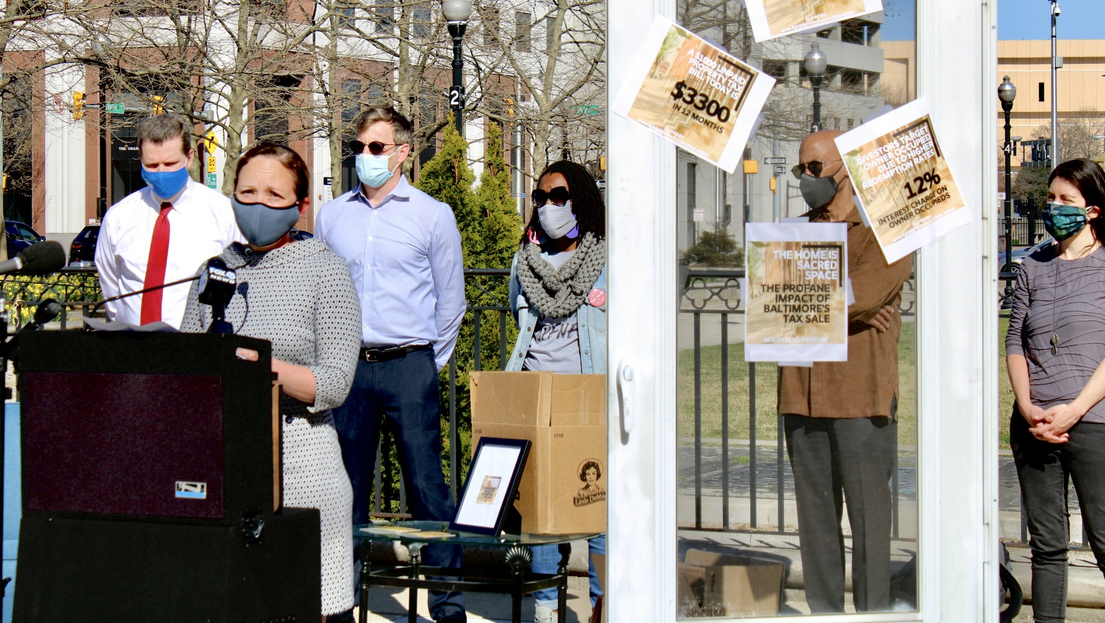 Calling for the mayor to take action on tax sales: Allison Harris, of the Pro Bono Resource Center of Maryland, with representatives of Fight Blight Bmore, the Maryland Volunteer Lawyers Service and others. (@PBRCMD)