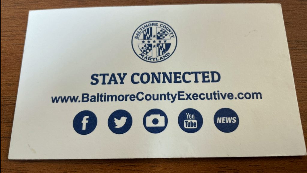 The back side of the business card used by a member of County Executive Olszewski's office. (Mark Reutter)
