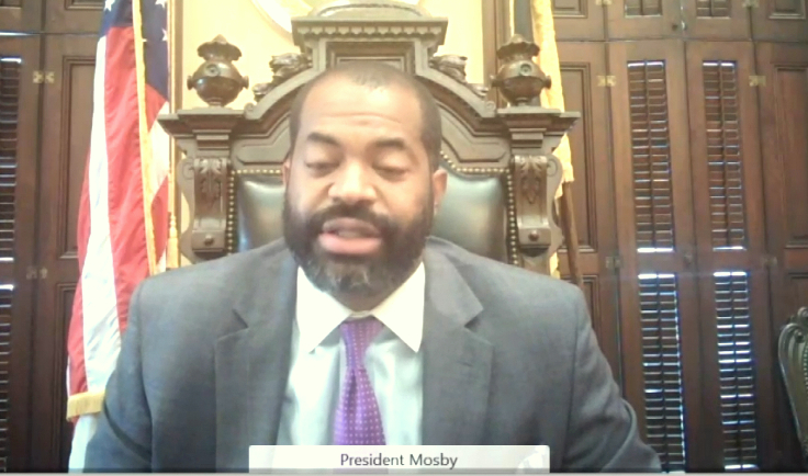 Nick Mosby left criticism of the travel rules in the hands of Rev. Little to and Comptroller Bill Henry, below. (CharmTV)