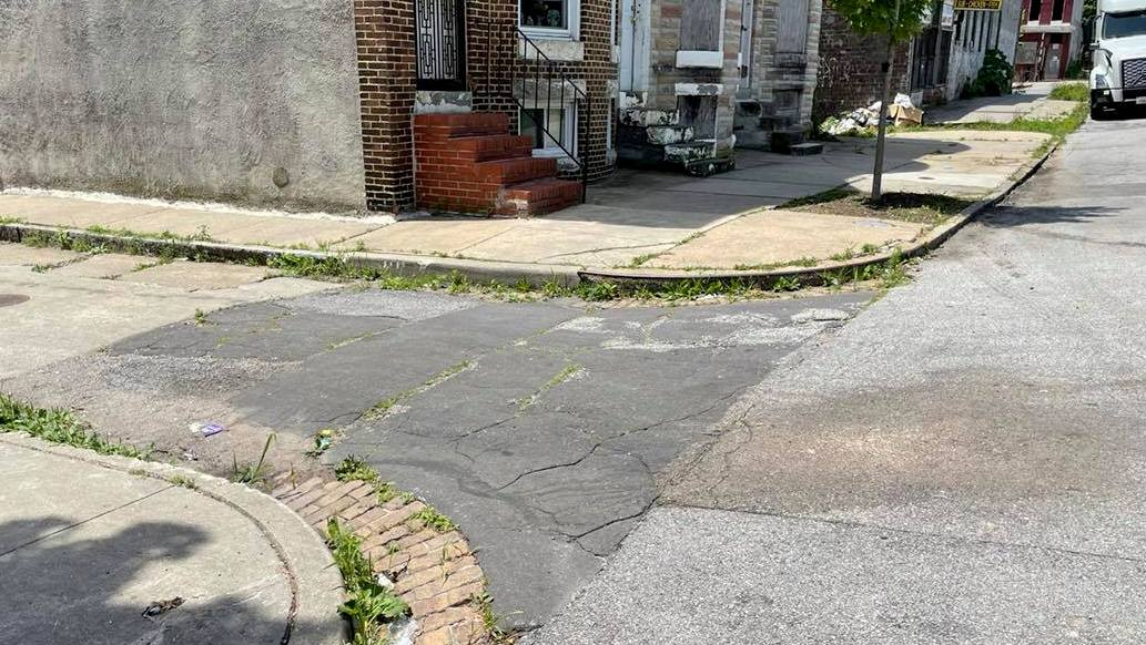 Curb ramp never installed at Bruce Street intersection with Westwood Avenue in West Baltimore. (Fern Shen)