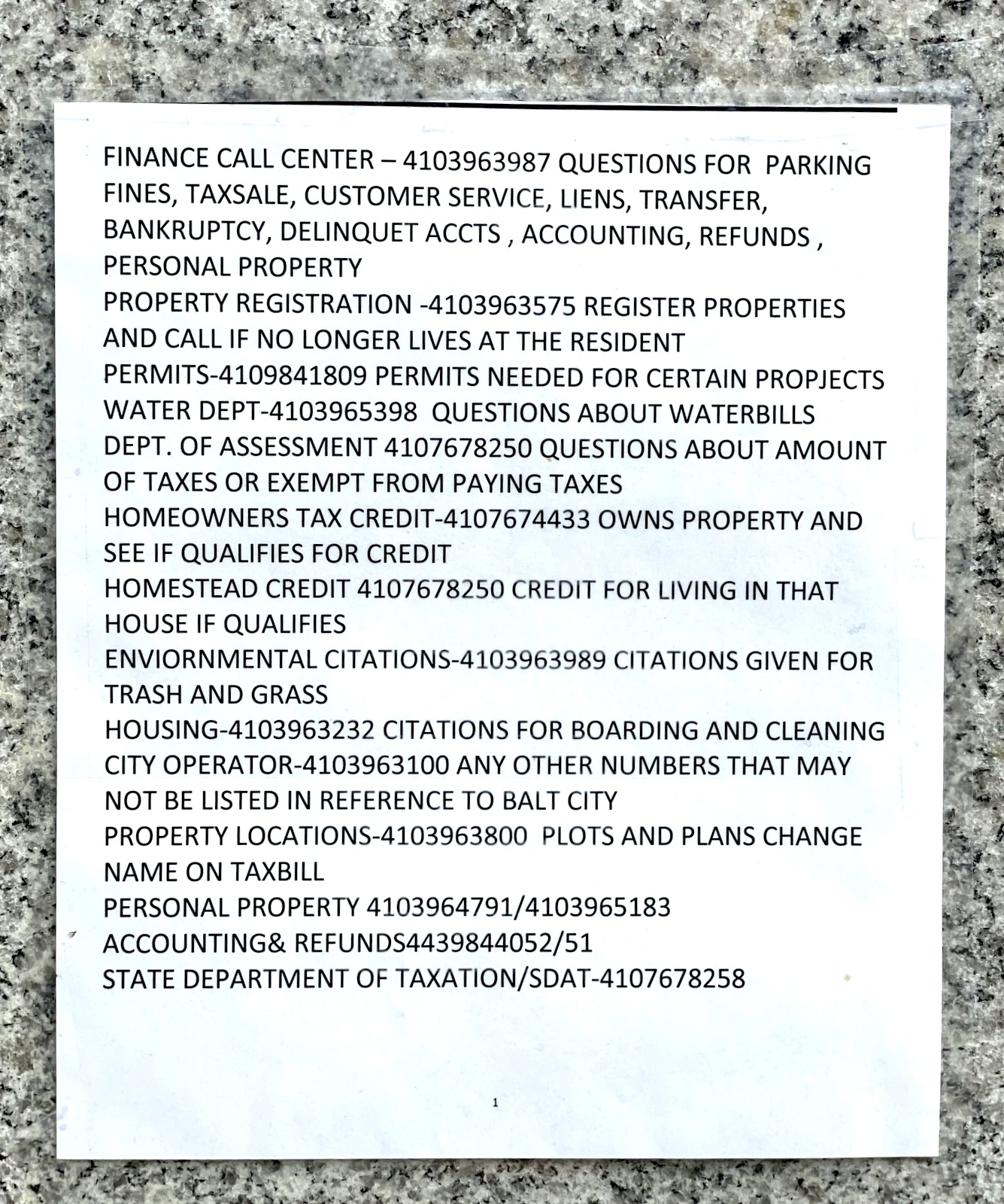 Sign outside the closed DPW building with city government phone numbers for residents to call. (Fern Shen)