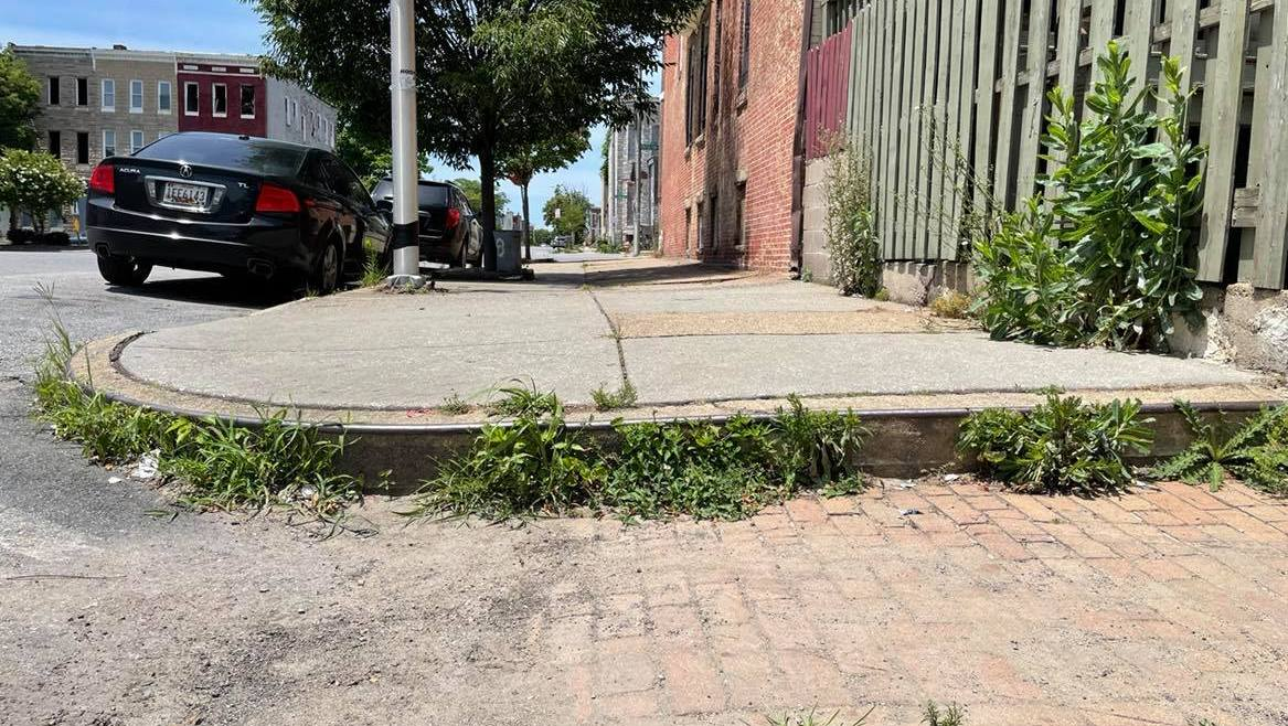 No curb ramp at all on Westwood Street in West Baltimore. (Fern Shen)