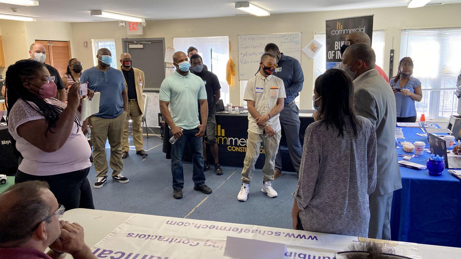 Organizers of a recent neighborhood job fair, the Pilmlico Terrace Neighborhood Association, address participants. (Timothy Dashiell)