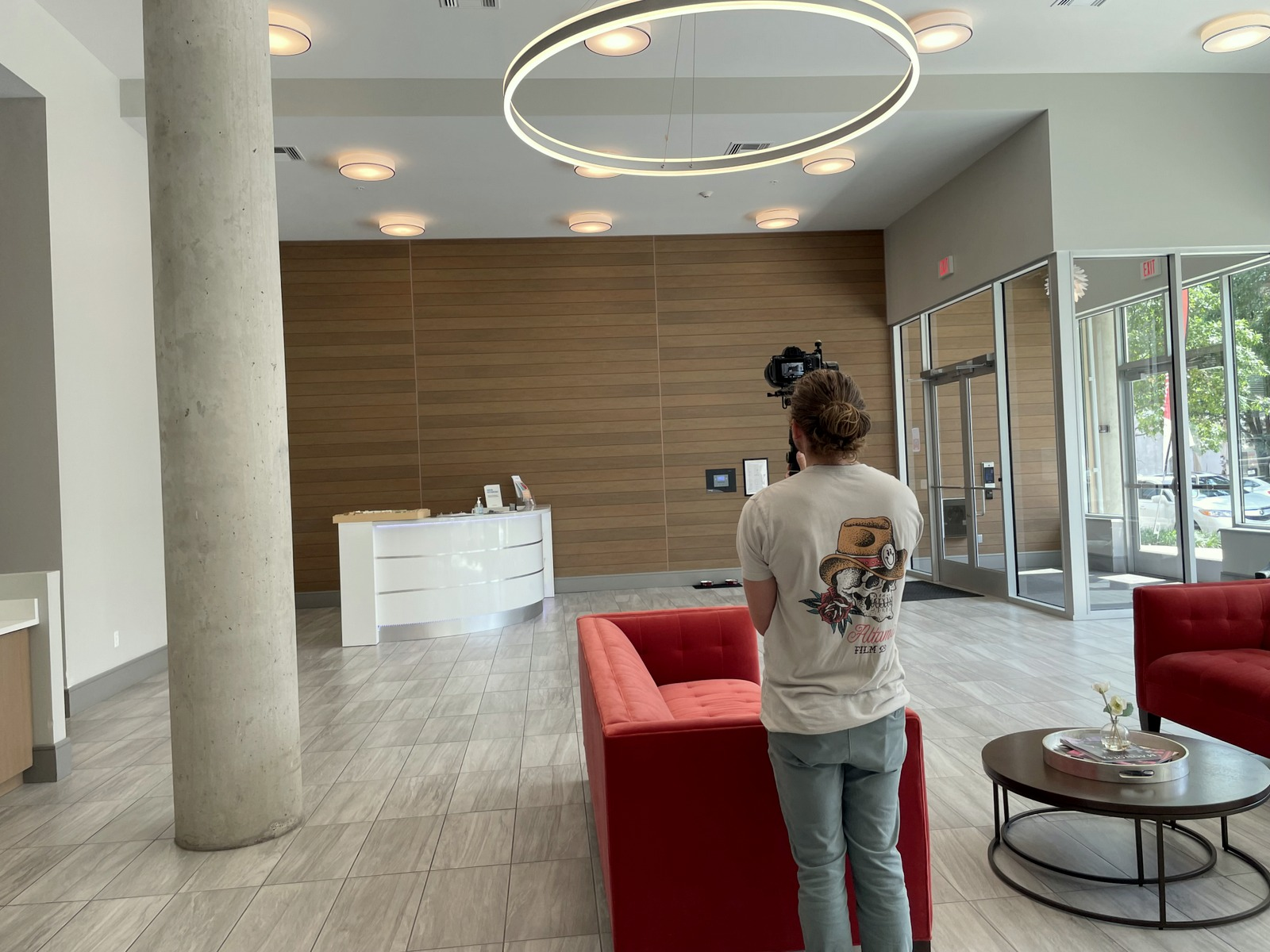 A cameraman films the lobby of one of the Center West buildings. (Fern Shen)