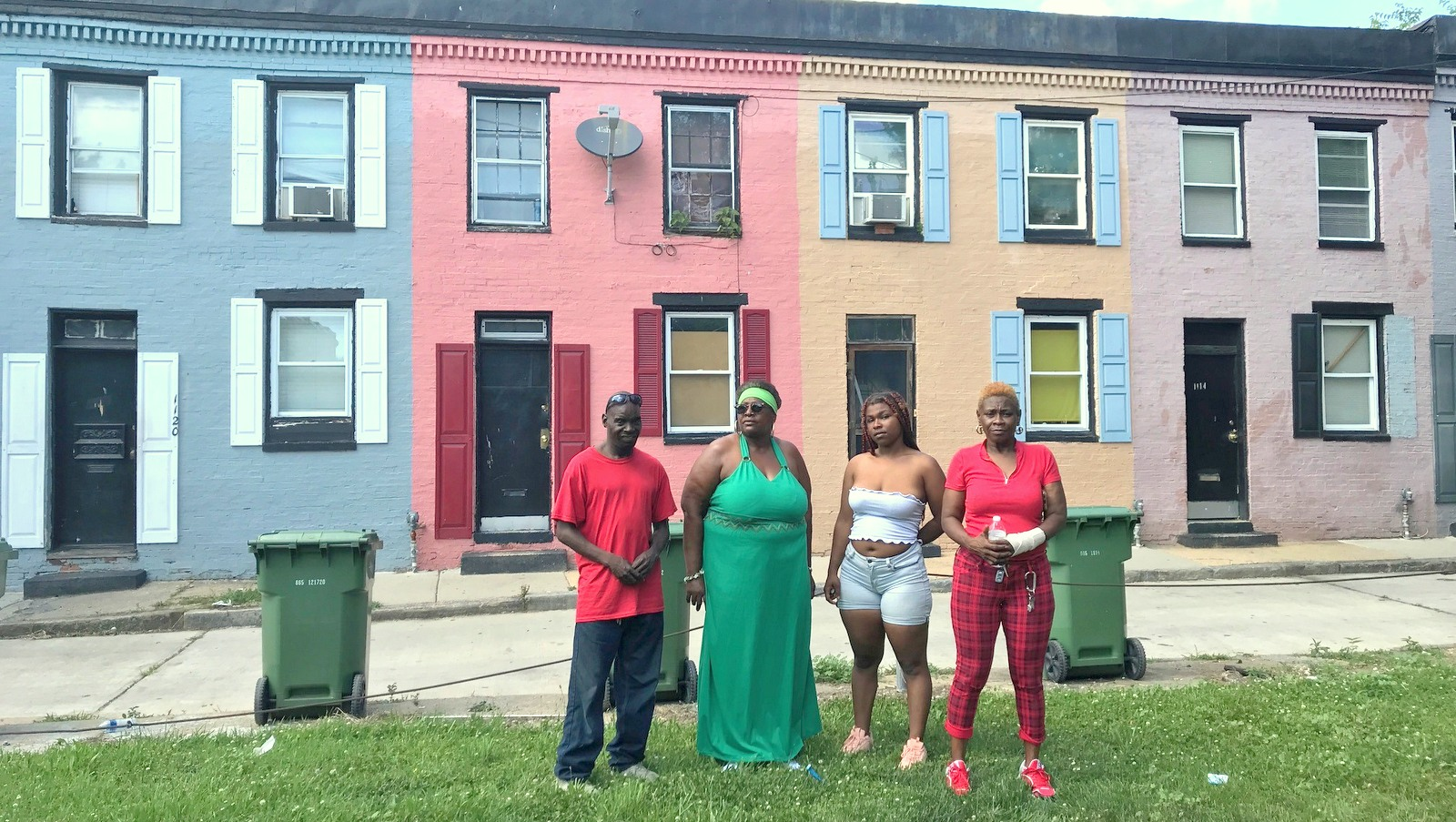 Jerome Phillips, Caroline Shoemaker, Laasia Howard and Vanessa McBride pose in front the Sarah Ann alley houses they've in for years. (Mark Reutter)