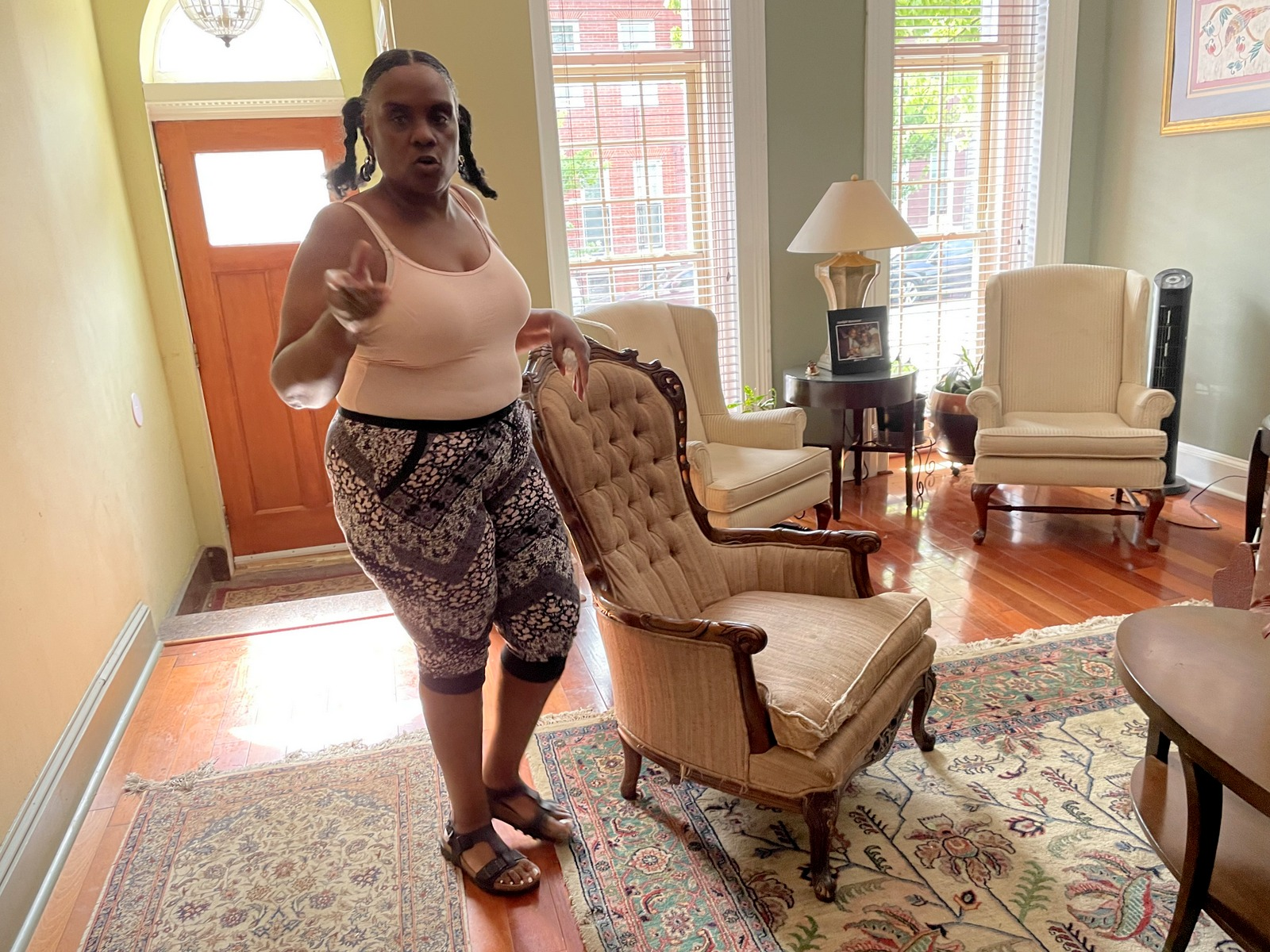 Sonia Eaddy in her house on CarrolltonAvenue, under condemnation proceedings by the city, and in her backyard with her husband Curtis. (Fern Shen)