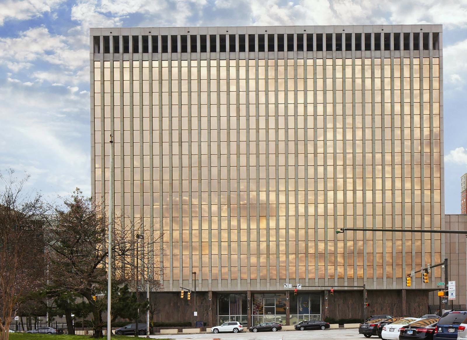 The gold-reflecting Bishop L. Robinson Sr. Police Administrative Building on East Fayette Street. (Mark Reutter)