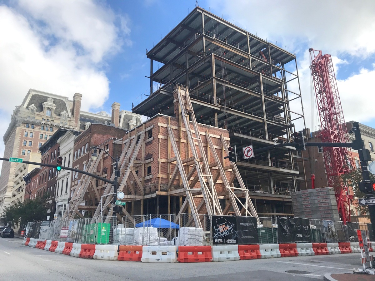 Landmark Partner's' eight-story office building is rises behind the former Grand Central nightclub, whose historic faces is shored up with heavy braces under construction. (Mark REutter)