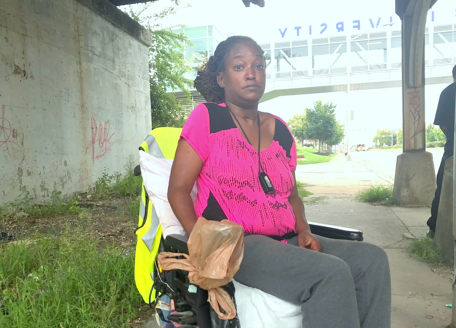 Equanna Fisher, who is wheelchair bound, lives at the Walbrook Mill Apartments just west of the CSX bridge. (Mark Reutter)