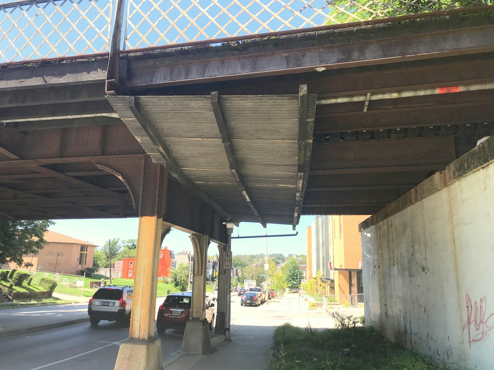 The north side of the bridge has a corrugated metal roof to protect pedestrians from falling debris. The south side of the bridge(BELOW) has open gaps throughout its length. (Mark Reutter)