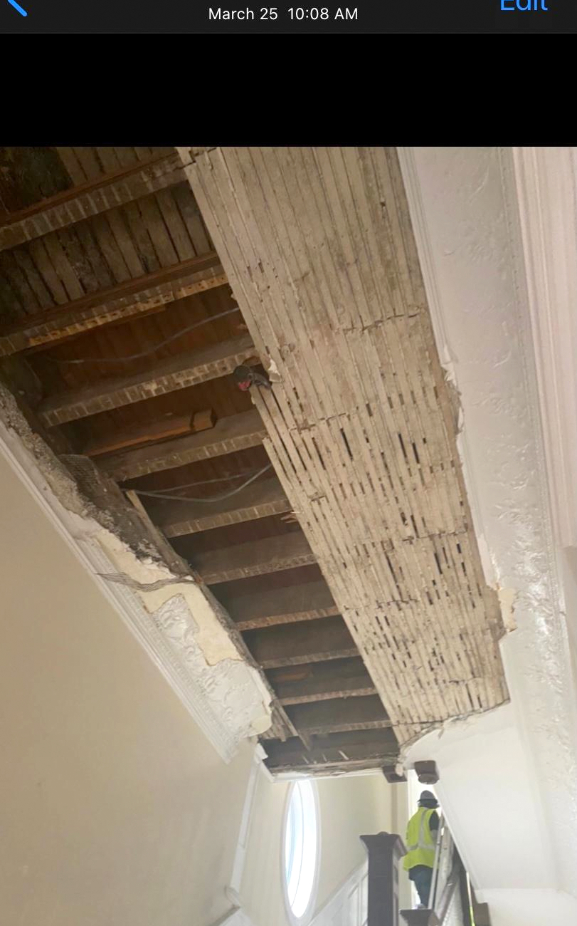 Damaged stairwell ceiling, time-stamped March 25, 2021. (Courtesy of former tenant)