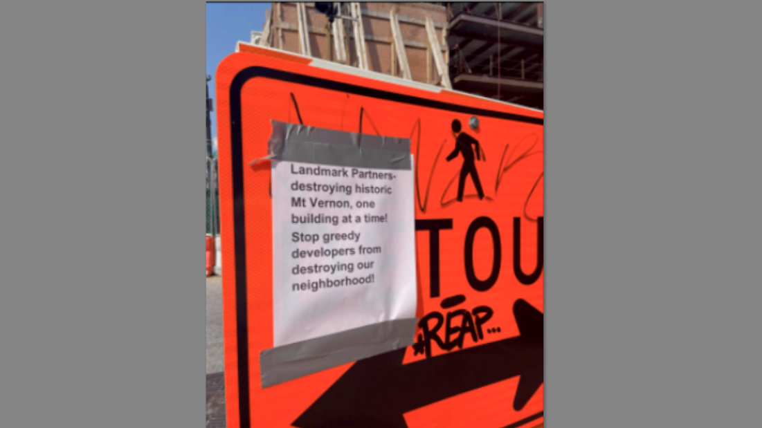 Fliers criticizing the developer have appeared in the area near the City House Charles project.