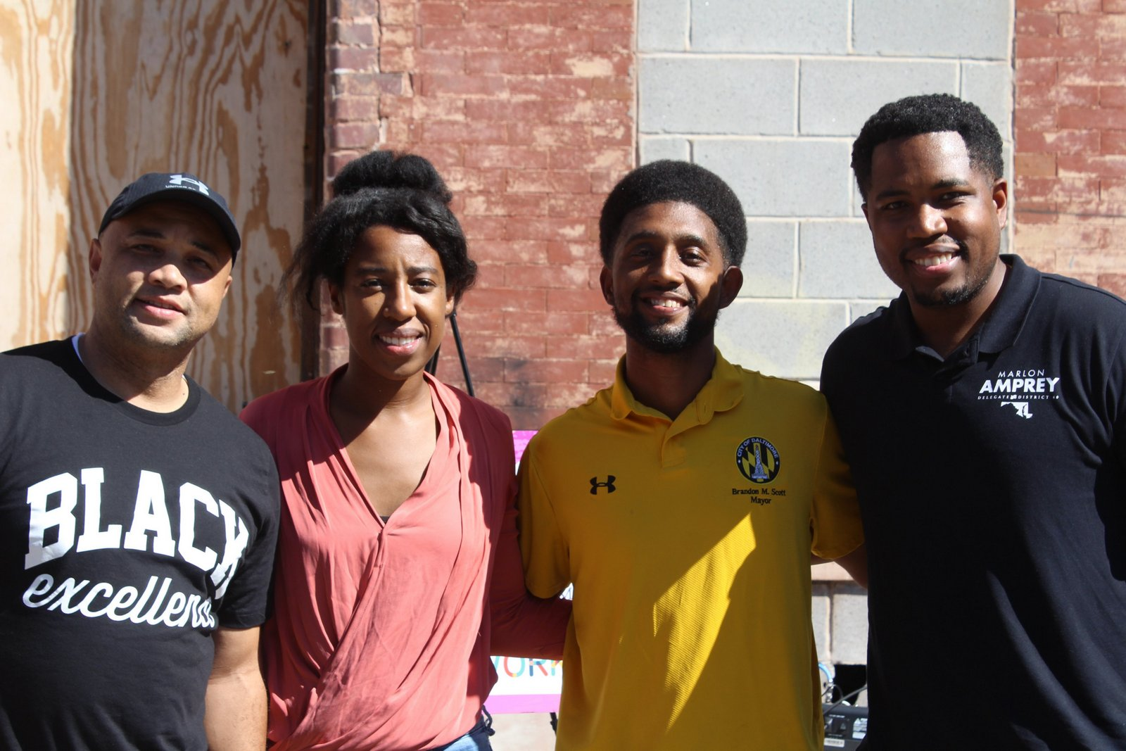 From left, Senator Antonio Hayes, Parity Homes founder Bree Jones, Mayor Brandon Scott and Delegate Marlon Amprey, all maskless, at an event on Saturday. (@MayorBMScott)