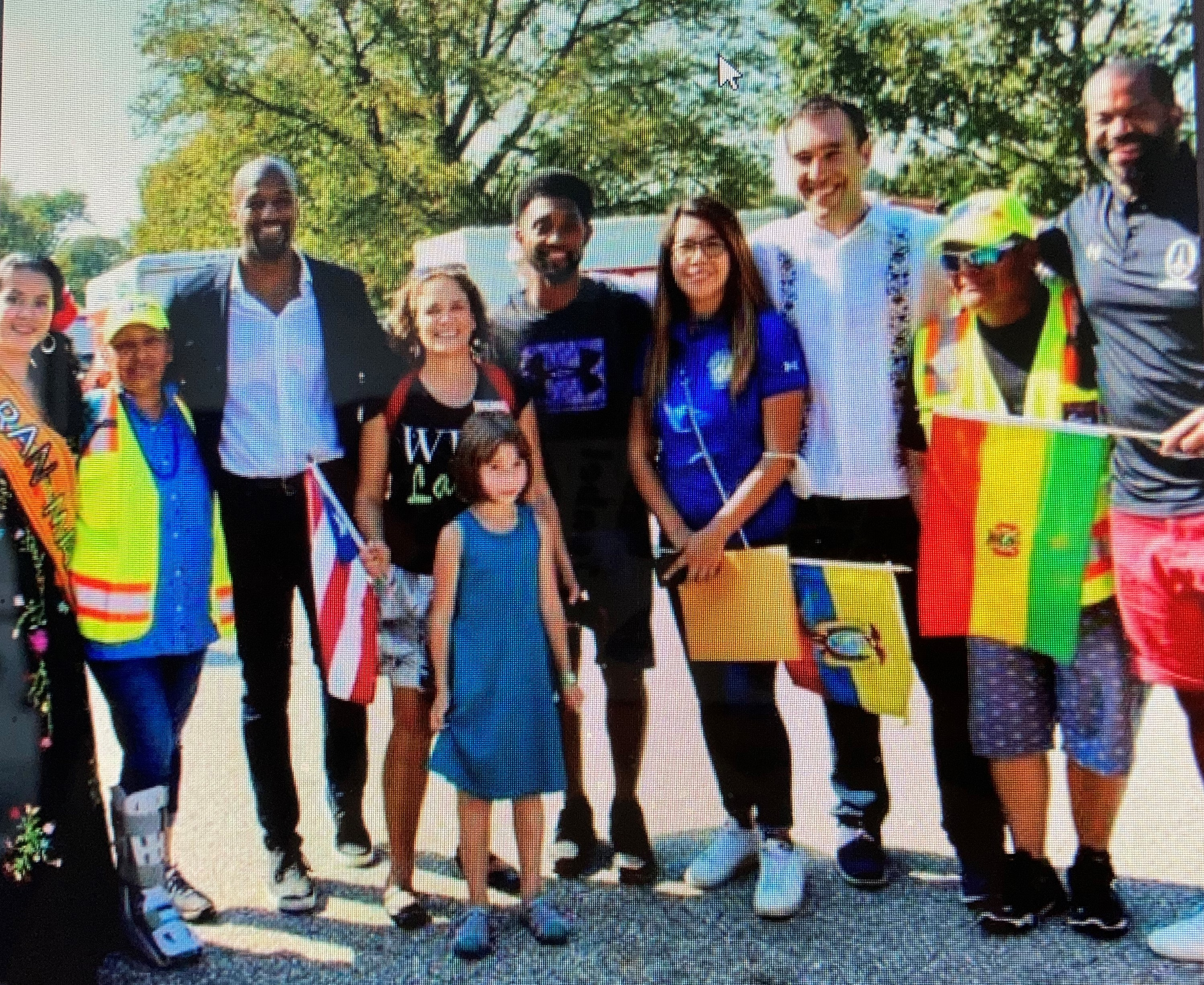 Council members Mark Conway, Odette Ramos, Zeke Cohen and (far right) Council President Nick Mosby pose all maskless with the mayor at yesterday's Latin Parade. To the immediate right of mayor is Catalina Rodriguez-Lima, director of the Mayor's Office of Immigrant Affairs. (Twittter)